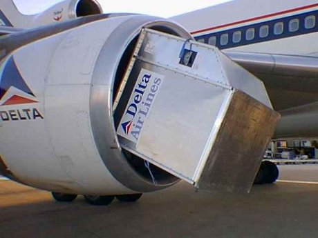 Delta luggage container wedged in Delta plane engine
