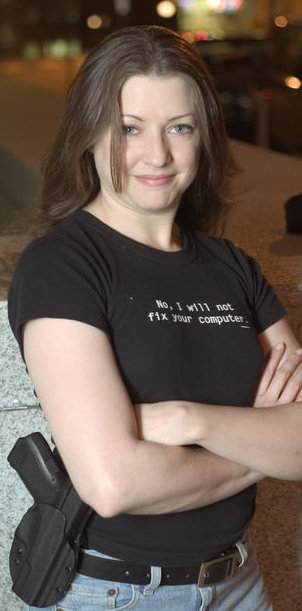 woman with 9mm and an 'I will not fix your computer' shirt