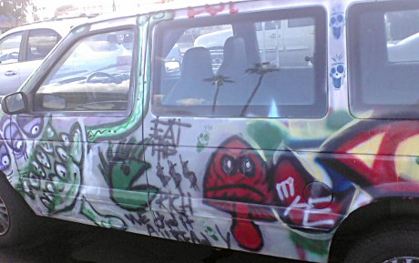 van with a bunch of amateur art on it