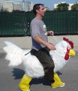 person running a marathon while wearing a costume that makes it look like he's riding a chicken