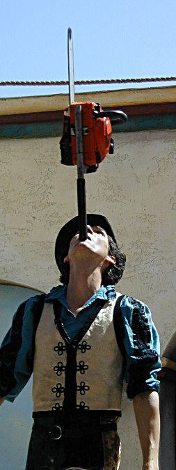 Dextre Tripp balancing a chainsaw on his chin