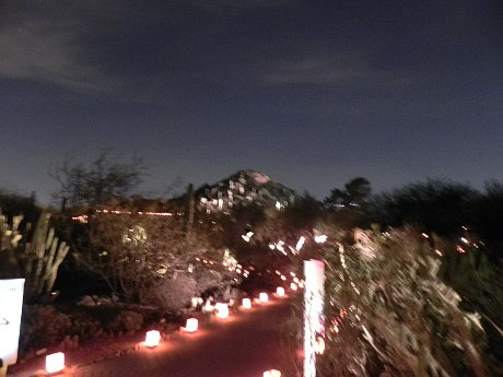 blurry photo of the lights on the mountainside at Luminarias