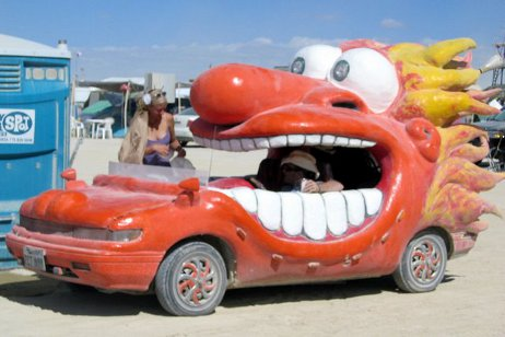 strange car that looks like a red cartoon person with an open mouth