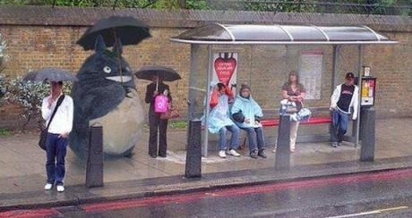 someone dressed up as Totoro at a bus stop in Japan
