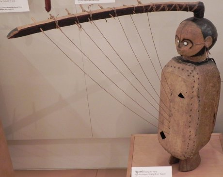 African harp that sort of looks like a person and is a little bit creepy