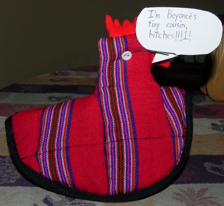 decorative chicken potholder saying 'I'm Beyonce's tiny cousin, bitches!!1!'