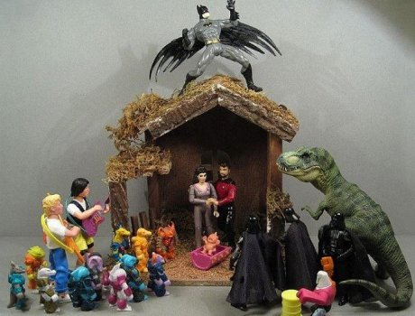 Nativity scene with Troi and Riker as Mary and Joseph, three wise Darth Vaders, Bill and Ted as shepherds, Batman as an angel, and dinosaurs and Battle Beasts as animals