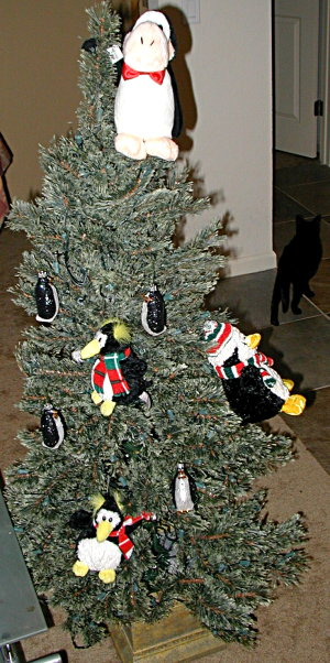 Christmas tree with penguins all over it